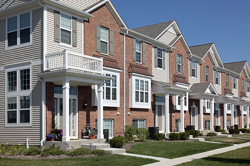 Row of brick townhouses with home loans